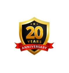 20 years anniversary golden shield badge logo vector image