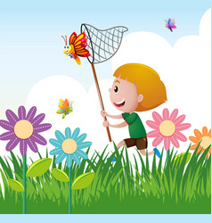 boy catching butterfly in the garden vector image