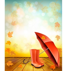 Autumn background with umbrella and rain boots vector