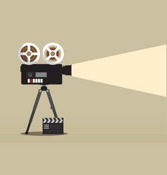 retro movie camera on tripod with film clap vector image