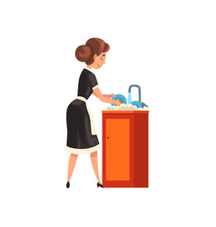 Smiling maid washing dishes in the kitchen vector
