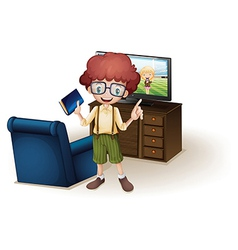 A boy holding a book standing near the blue couch vector image