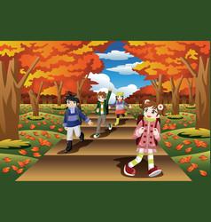 Kids hiking in the fall season vector