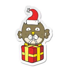 Sticker of a cartoon christmas owl vector