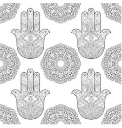 Hand of fatima with mandala seamless pattern vector