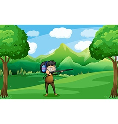 A man with a gun at the forest vector image vector image