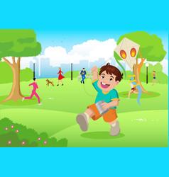 Boy playing a kite at city park vector