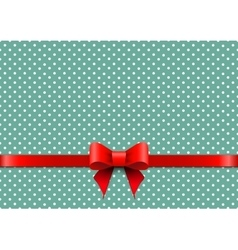Christmas background with polka dots and red bow vector image