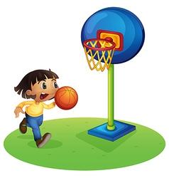 A small boy playing basketball vector image vector image