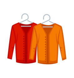 Female red and yellow sweaters on hangers isolated vector