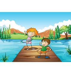 Two kids playing hulahoop at the river vector