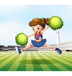 A cheerdancer with green pompoms at the soccer vector image vector image