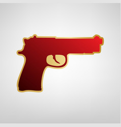 Gun sign red icon on gold vector