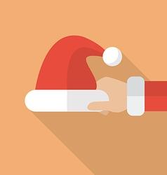 Santa hand holding Santa hat vector image
