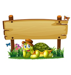 A smiling turtle below the empty wooden board vector image vector image