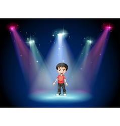 A young actor at the center of the stage vector image