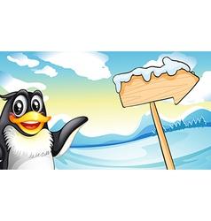 A penguin beside the wooden arrow signboard vector