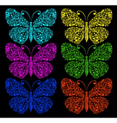 butterflies on a black background vector image
