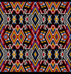 Tribal seamless pattern with mexican huichol art vector
