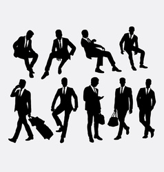 Businessman sitting and standing silhouettes vector
