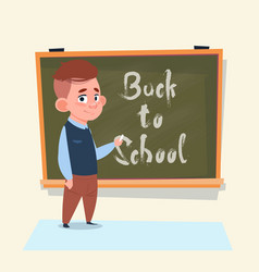 back to school small boy standing over class board vector image vector image