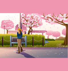 girl walking during cherry blossom vector image