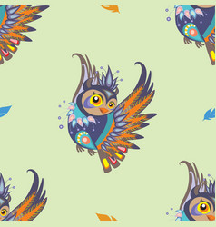 Seamless pattern with owl and feathers vector