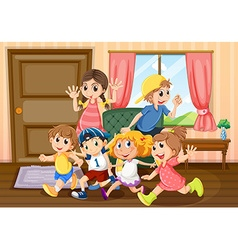 Children running around the room vector image