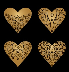 Set of ornamental golden hearts vector