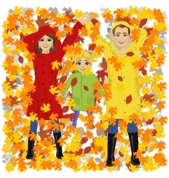 young happy family lying on autumn leaves in park vector image