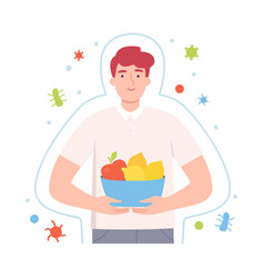 Young male character holding vitaminic fruits vector
