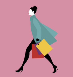 fashionable woman with shopping bags walking on vector image