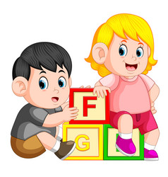 Kids playing with alphabet block vector