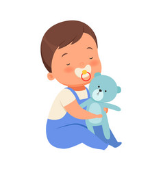 Boy with toy teddy bears is sitting vector