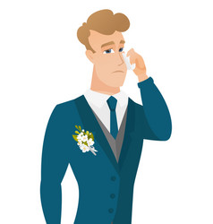 Young caucasian groom crying vector