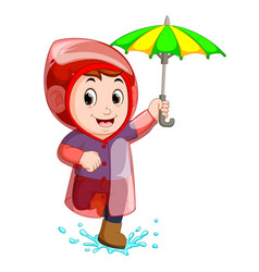 little boy wearing raincoat and holding umbrella vector image