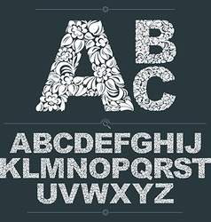 Set of ornate capitals flower-patterned typescript vector