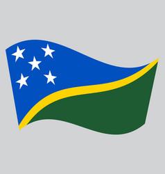 Flag of solomon islands waving on gray background vector