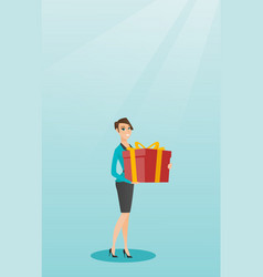 Young caucasian woman holding box with gift vector