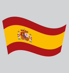 Flag of spain waving on gray background vector