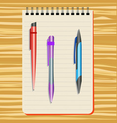 Notebook red pen purple pen and blue pen vector