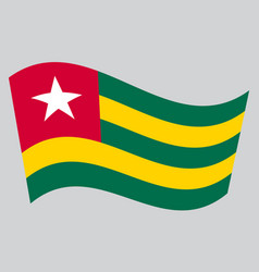 flag of togo waving on gray background vector image