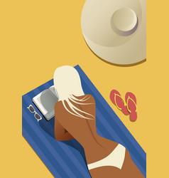 girl reading on beach lying on a towel vector image