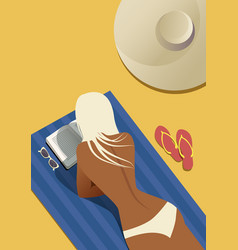 girl reading on the beach lying on a towel vector image