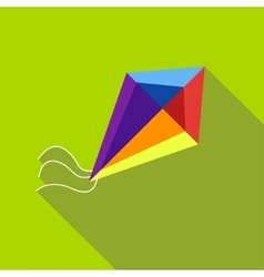 A child s toy a kite on a bright green background vector image