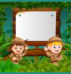 Two kids on a jungle adventure with blank wood vector