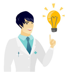 young asian doctor pointing at idea light bulb vector image vector image