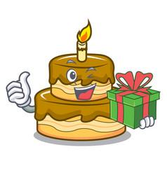 With gift birthday cake mascot cartoon vector