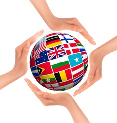 Hands holding globe with flags of world vector image vector image