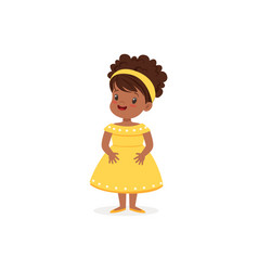 Beautiful black little girl posing in yellow dress vector